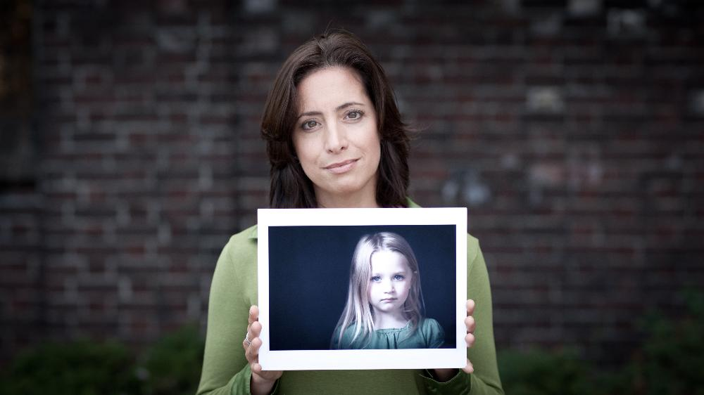 Women holding photo of a child
