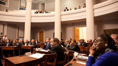 Chief Justice Mark Martin (far left), Associate Justice Mike Morgan (left), Associate Justice Robin Hudson (center), and former Associate Justice Patricia Timmons-Goodson (right) look on as the 1868 North Carolina Constitutional Convention is reenacted.