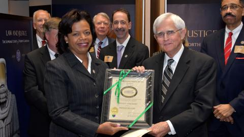 Chief Justice Cheri Beasley presents Friend of the Court award to Justice Willis Whichard