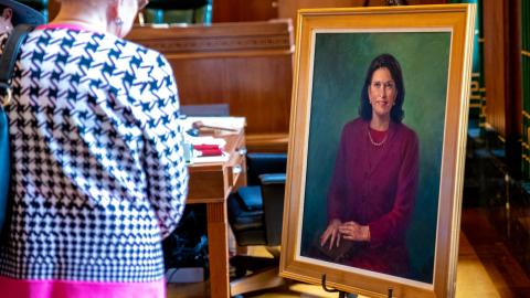 Special guests viewing Clerk Roeder's portrait during the presentation ceremony in March.