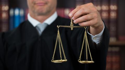 Judge holding justice scales