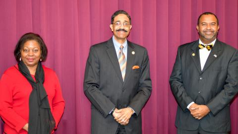 Associate Justice Michael Morgan (center) standing with Judge Wanda Bryant and Judge Fred Gore