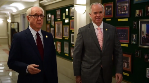 Former Chief Judge Gerald Arnold (left) and Mel Wright walk the halls of the North Carolina Court of Appeals.